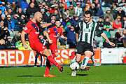 Plymouth Argyle's Carl McHugh has a shot blocked by York City's Russell Penn during the Sky Bet League 2 match between Plymouth Argyle and York City at Home Park, Plymouth, England on 28 March 2016. Photo by Graham Hunt.