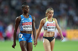 London, August 08 2017 . Gloria Hooper, Italy and Rebekka Haase, Germany, make their way t the start in the women's 200m heats on day five of the IAAF London 2017 world Championships at the London Stadium. © Paul Davey.