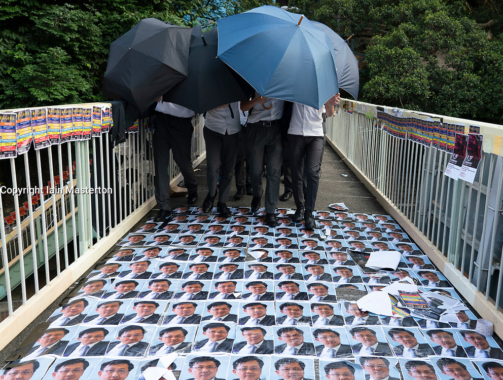 Wanchai, Hong Kong. 26 September, 2019. Human chain formed by students from local secondary schools in Hong Kong to support the pro democracy movement and anti-extradition bill. Local school students march over photos Julius Ho stuck to footbridge.
