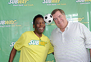 Soccer legend Pele celebrates with Tony Pace, Chief Marketing Officer, SUBWAY restaurants, after being named the brand's newest global ambassador, Thursday, July 31, 2013, at Chelsea Piers in New York. (Photo by Diane Bondareff/Invision for SUBWAY restaurants/AP Images)