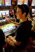 Casey gambling on slot machines on a mediterranean cruise ship