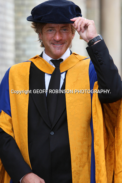 "PIC SHOWS RICHARD  MADLEY IN CAMBRIDGE ON WEDNESDAY WHERE HE RECEIVED AN HONORARY DEGREE... Television icon Richard Madeley was joined by wife Judy Finnigan today (Wed) as he received an honorary degree in Cambridge...The 55-year-old presenter joked on Twitter that he would have to have a pipe and rimless glasses to make him appear more learned at the ceremony in the city's Corn Exchange...""Cambridge on Wednesday for an honorary degree. Get me! You'll have to pay to speak to me from now on,"" he tweeted...""May buy small briar pipe to make me appear more learned. Pince-nez,or rimless glasses, perhaps? And leave comb in hair for absent-minded prof look.""..The TV star, most famous for working with wife Judy on This Morning, also said he had cut his hair in preparation for receiving the Honorary Doctor of Letters from Anglia Ruskin University...His two children, Jack and Chloe, were there to see their dad honoured for his contribution to television, entertainment and media."