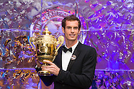 Andy Murray with his Mens Singles Trophy for winning 2013 Wimbledon Tennis Championship, London, UK.