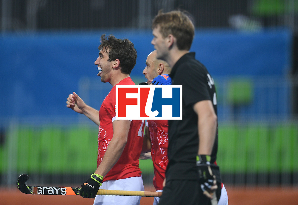 Britain's David Condon (L) gestures after scoring a goal  during the men's field hockey Britain vs New Zealand match of the Rio 2016 Olympics Games at the Olympic Hockey Centre in Rio de Janeiro on August, 7 2016. / AFP / MANAN VATSYAYANA        (Photo credit should read MANAN VATSYAYANA/AFP/Getty Images)