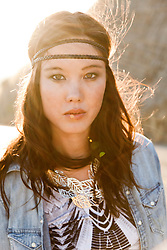 Young Woman with Headband on Forehead Outdoors
