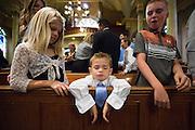 Stefanie and James celebrate their Catholic wedding with family and friends at All Saints Catholic Church in Hayward, California, on October 12, 2013. (Stan Olszewski/SOSKIphoto for Terra Tabbytosavit Photography)