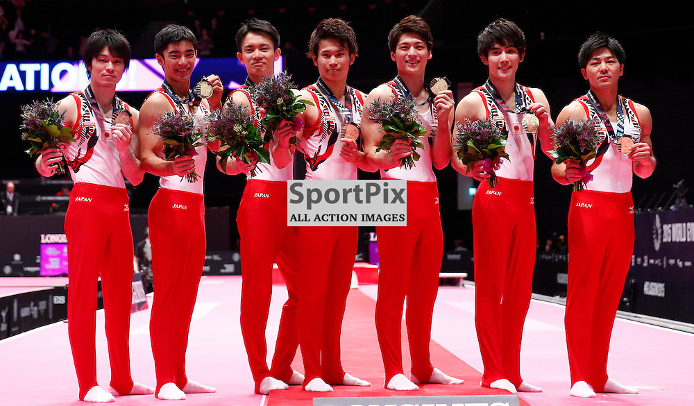 2015 Artistic Gymnastics World Championships being held in Glasgow from 23rd October to 1st November 2015....The team from Japan celebrate winning gold in the Men's Team Final...(c) STEPHEN LAWSON   SportPix.org.uk