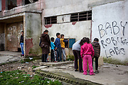 Residents and children queue up for water which is switched off in several highrise buildings at Lunik IX. The water in this building was cut off for all inhabitants because of unpaid bills from the past. People living in that building can get twice a day water from a pipe, for one hour. LUNIK IX is populated with almost 100% Roma inhabitans and  in the western-central part of the city of Kosice located in Eastern Slovakia. The living conditions in Lunik IX are partly very bad and many people do not have electricity, water or gas. Some of the buildings are completely devasted.