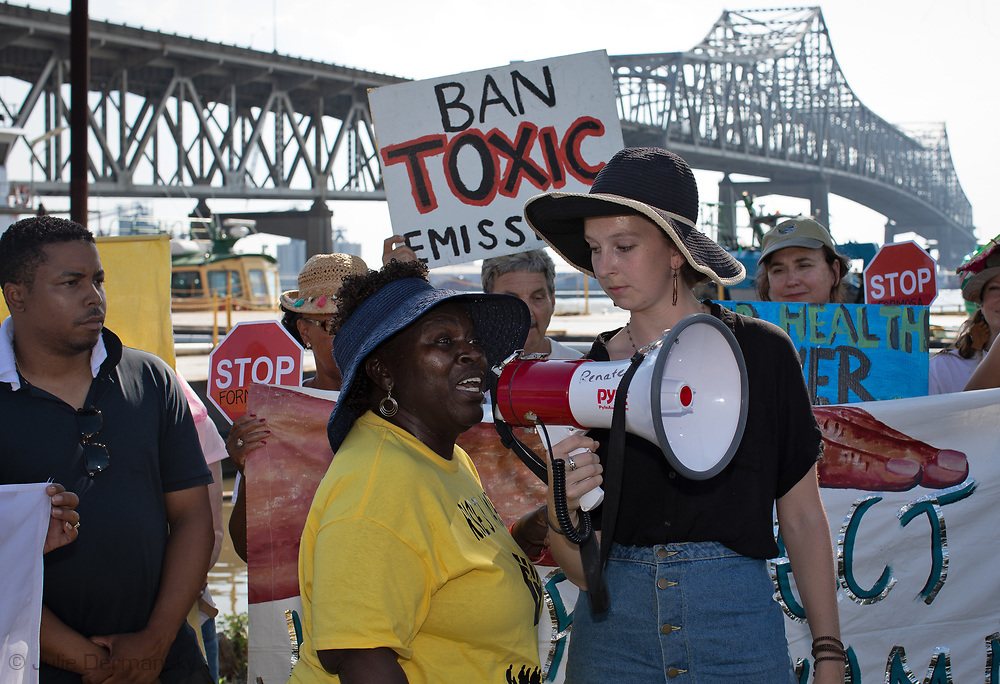 "Members of CADA and supporters at the foot of the I-10 Bridge in Baton Rouge, Louisiana on the fourth day of the Coalition Against Death Alley's 5 day march. The Coalition Against Death Alley (CADA), is a group of Louisiana-based residents and members of various local and state organizations, is calling for a stop to the construction of new petrochemical plants and the passing of stricter regulations on existing industry in the area that include the groups RISE St. James, Justice and Beyond, the Louisiana Bucket Brigade, 350 New Orleans, and the Concerned Citizens of St. John. Louisiana's Cancer Alley, an 80-mile stretch along the Mississippi River, is also known as the ""Petrochemical Corridor,"" where there are over 100 petrochemical plants and refineries."