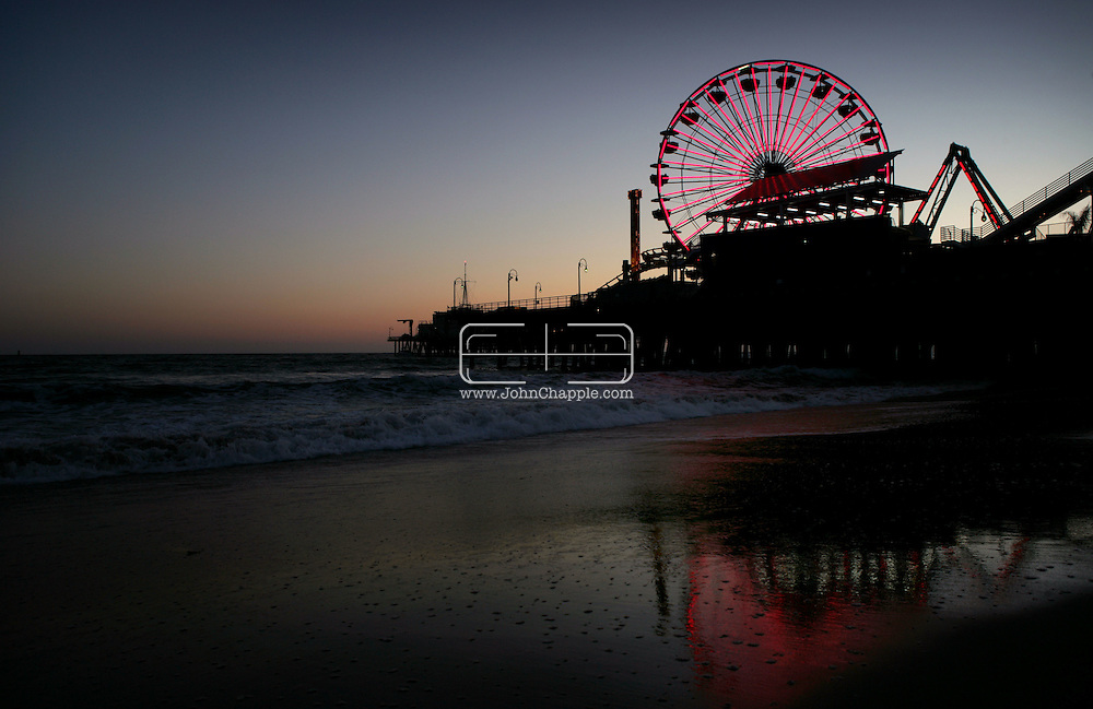 """30th May 2008, Santa Monica, California. One of Southern California's oldest landmarks, the Santa Monica Pier, showed off a brand new $1.5-million Ferris wheel. With 160,000 LED lights it is 75 percent more energy efficient than the last wheel. The previous wheel, seen in 28 movies, including the current hit """"Ironman"""", was auctioned on Ebay for $132,000. PHOTO © JOHN CHAPPLE / REBEL IMAGES.john@chapple.biz   www.chapple.biz"""