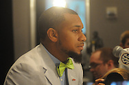 Donte Moncrief talks with reporters during the SEC football Media Days in Hoover, Ala., Tuesday, July 16, 2013.
