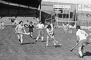 Cork about to slide the slitor onto her hurlie as a Wexford player comes in from behind during the All Ireland Senior Camogie Final Cork v Wexford in Croke Park on the 21st September 1975. Wexford 4-3 Cork 1-2.