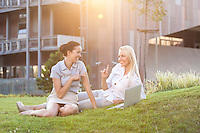 Young businesswomen spending leisure time on office lawn