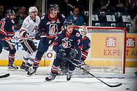 KELOWNA, CANADA - MARCH 25: Gage Quinney #7 of Kamloops Blazers skates with the puck against the Kelowna Rockets on March 25, 2016 at Prospera Place in Kelowna, British Columbia, Canada.  (Photo by Marissa Baecker/Shoot the Breeze)  *** Local Caption *** Gage Quinney;