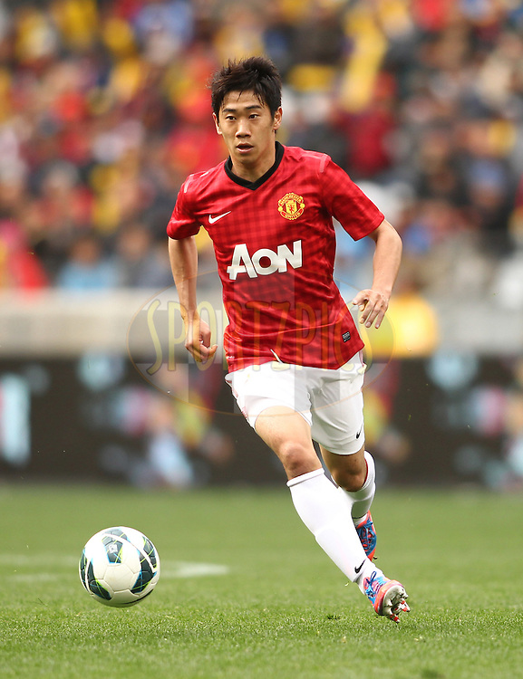Shinji Kagawa of Manchester United during the Football Invitational 2012 match between Ajax Cape Town and Manchester United held at Cape Town Stadium on 21 July 2012 in Cape Town, South Africa..Photo by Shaun Roy / Sportzpics