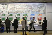 Mar 3, 2006; Tokyo, JPN; Akihabara.Passengers purchase train tickets at Akihibara Station...Photo Credit: Darrell Miho .Copyright © 2006 Darrell Miho .