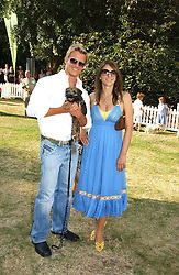 DR SCOTT MILLER, his dog and LIZ HURLEY at the Macmillan Cancer Support Dog Day held in the gardens of the Royal Hospital, Chelsea, London on 4th July 2006.<br />