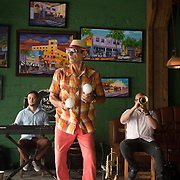 JUNE 9, 2016---MIAMI, FLORIDA<br /> Orestes Sosa, dances as he plays the maracas with a trio performing mostly Cuban songs in one of Little Havana's hottest spots Ball and Chain.<br /> (Photo by Angel Valentin/Freelance)