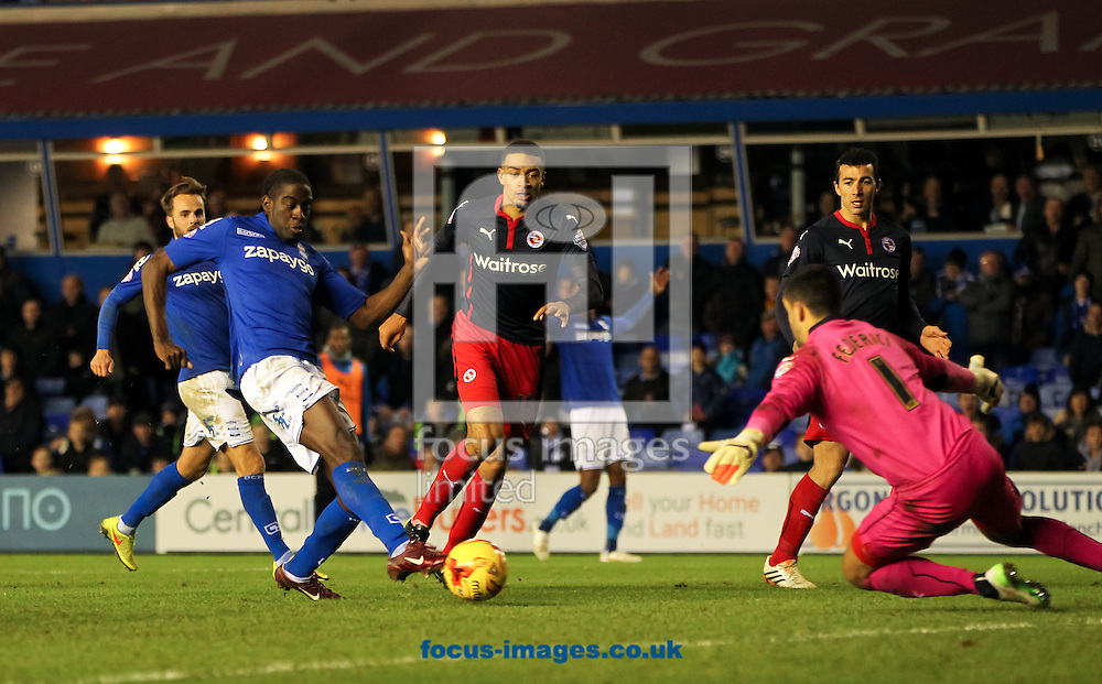 Clayton Donaldson (2nd left) of Birmingham City has his shot at goal saved by Adam Federici (right) of Reading during the Sky Bet Championship match at St Andrews, Birmingham<br /> Picture by Tom Smith/Focus Images Ltd 07545141164<br /> 13/12/2014
