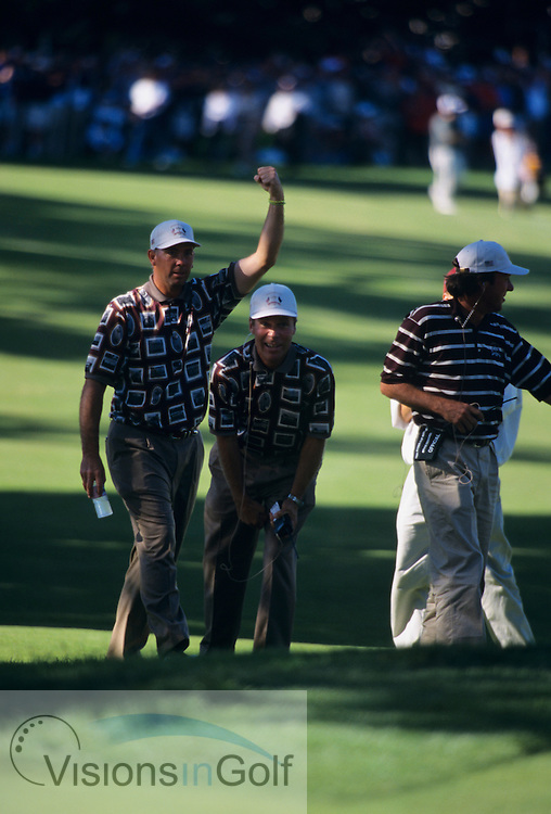 Tom Lehman and Captain Ben Crenshaw celebrate punching the air as mark O'Meara gets a half<br /> 990927 / THE COUNTRY CLUB, BROOKLINE, BOSTON, USA / PHOTO MARK NEWCOMBE / 33rd RYDER CUP 1999