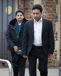 © Licensed to London News Pictures. 22/02/2018. Reading, UK. Family friend and spokesman Matthew John (R) arrives at Reading Crown Court with Ancy Joseph, wife of victim Cyriac Joseph,  for the trial of drivers involved in a crash that killed eight people on the M1 in August 2017. Ryszard Masierak charged with causing eight deaths by dangerous driving and being over the drink-driving limit after six men and two women were killed in a collision on the M1 at Newport Pagnell when the minibus they were travelling in was almost flattened in a crash. Masierak and another driver David Wagstaff face 12 charges in total - eight counts each of causing death by dangerous driving and four counts each of causing serious injury by dangerous driving. Photo credit: Peter Macdiarmid/LNP