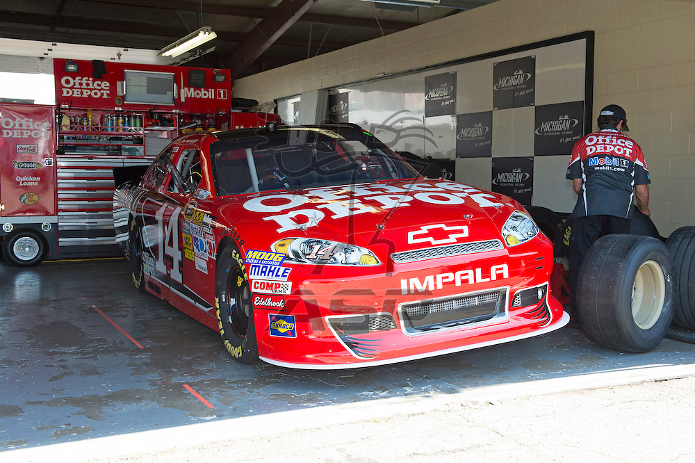 Brooklyn, MI - JUN 15, 2012: Tony Stewart's race car in the garage during practice for the Quicken Loans 400 race at the Michigan International Speedway in Brooklyn, MI.
