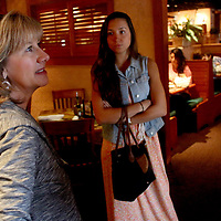 Tania Tayloe, left and Rachael Gallelli talk while waiting for the Parrish family to show up at Carrabba's Italian Grill. (Jason A. Frizzelle)