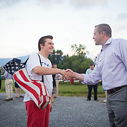 Prince William County Supervisor, Corey Stewart greets Isaac Stroupe, 15, during an appearance at the Page County , VA GOP Jamboree, in Luray, VA on Saturday, June 25, 2016.  Stewart ran the Trump operation in Virginia and is running for Governor in 2017.  Stewart mingled with guests and made a brief speech, along with other candidates for political office in Virginia.  John Boal Photography