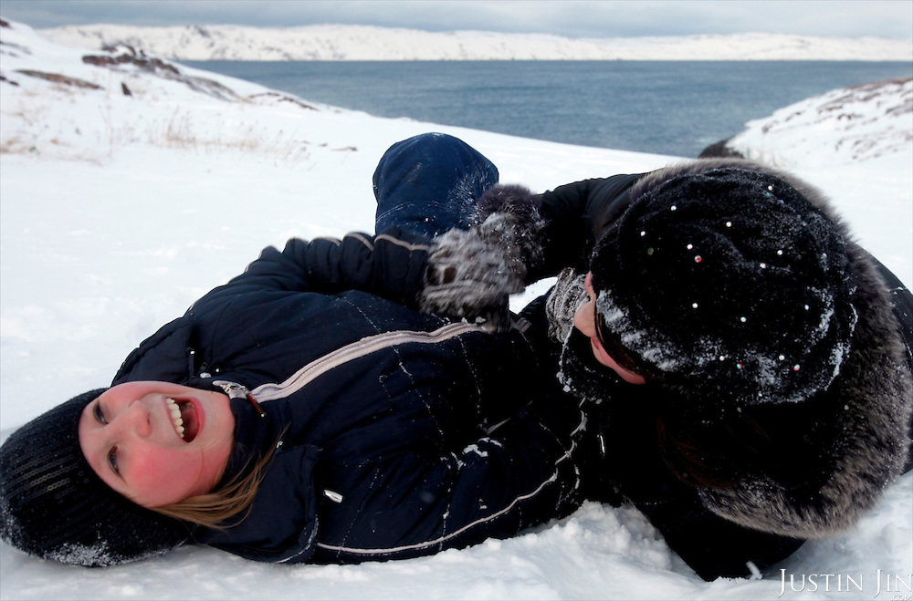 Two girls play in the snow on the Arctic Coast in a dying fishing and farming community. Today it is again in the spot-light with the construction of a landing base for a gas pipeline from the world's largest know natural gas field.