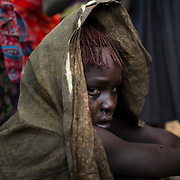 A Pokot girl cries after being circumcised.