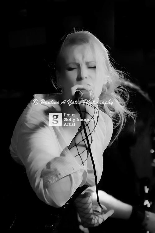 Solsikk performing at Femme Metal Music Festival London. Lead signer in Black & White