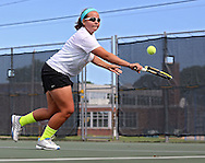 Iowa City West's Elena Wilson reaches out for a backhand return during the Class 2A state team tennis tournament at Veterans Memorial Tennis Center in Cedar Rapids on Saturday, June 1, 2013.