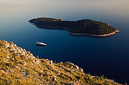 Cruise ship in the Adriatic Sea approaching the historic harbor of Dubrovnik, Croatia, a UNESCO World Heritage Site
