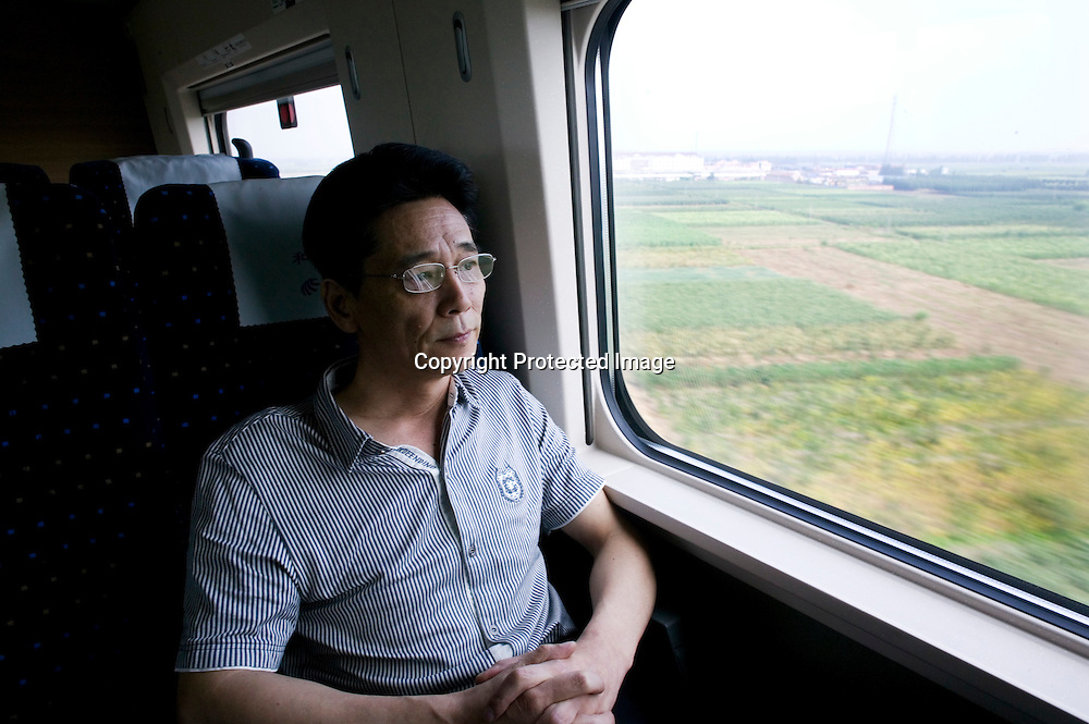 Beijing-Shanghai bullet train, Sept.11,2011: Sun Xiaosu, 56, Shanghai traditional food restaurant owner..When he sees the train, he says to himself development went fast after.the economic reforms. And transportations are a pillar of the economy.: people move faster, they save time, and there's more tracks.available for goods trains. With a laugh, he says he never even.considered trying to sell his food in the train's restaurants : one.reason is, in China, without good personal connections, you have no.chance to earn this kind of contracts.