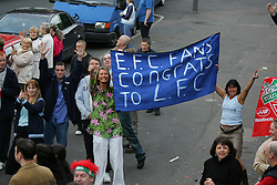 LIVERPOOL, ENGLAND - THURSDAY, MAY 26th, 2005: Everton fans cheer on the Liverpool players as they parade the European Champions Cup on on open-top bus tour of Liverpool in front of 500,000 fans after beating AC Milan in the UEFA Champions League Final at the Ataturk Olympic Stadium, Istanbul. (Pic by David Rawcliffe/Propaganda)