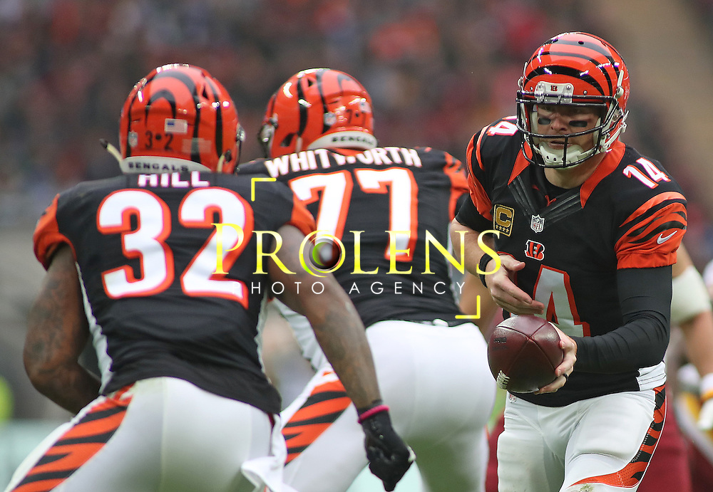 NFL International Series 2016 Washington Redskins @ Cincinnati Bengals 30th OCT 2016<br /> <br /> Cincinnati Bengals Quarterback Andy Dalton (14) hands off to Cincinnati Bengals Running Back Jeremy Hill (32)  during game 17 of the NFL International Series between the  Washington Redskins and Cincinnati Bengals, From Wembley Stadium, London.<br /> <br /> Pic Micthell Gunn / PLPA? ProLens Photo Agency.<br /> Sunday 30 October 2016
