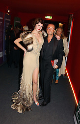 "Model JASMINE GUINNESS and fashion designer JULIEN MACDONALD at the 10th annual British Red Cross London Ball.  This years ball theme was Indian based - ""Yaksha - Yakshi: Doorkeepers to the Divine"" and was held at The Room, Upper Ground, London on 1st December 2004.  Proceeds from the ball will aid vital humanitarian work, including HIV/AIDS projects that the Red Cross supports in the UK and overseas.<br />