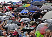 © licensed to London News Pictures. ASCOT, UK.  16/06/11. Umbrellas were the order of the day. Ladies Day at Royal Ascot 16 June 2011. Royal Ascot has established itself as a national institution and the centrepiece of the British social calendar as well as being a stage for the best racehorses in the world. Mandatory Credit Stephen Simpson/LNP