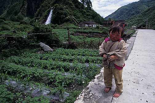 China, People, Tibetan farmers, Young Child crying because of parental discipline. Sichuan.
