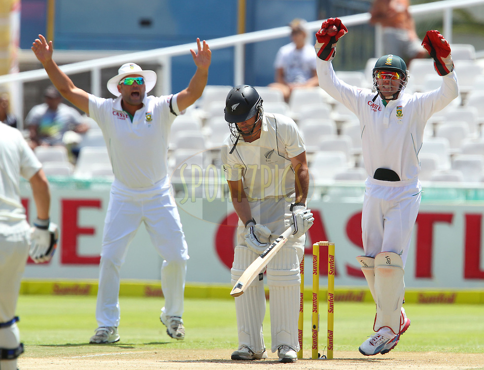 Jacques Kallis and AB deViliers appeal for the wicket of Dean Brownlie during the 3rd day of the 1st Sunfoil Test match between South Africa and New Zealand held at Newlands Stadium in Cape Town, South Africa on the 4th January 2013..Photo by Ron Gaunt/SPORTZPICS .