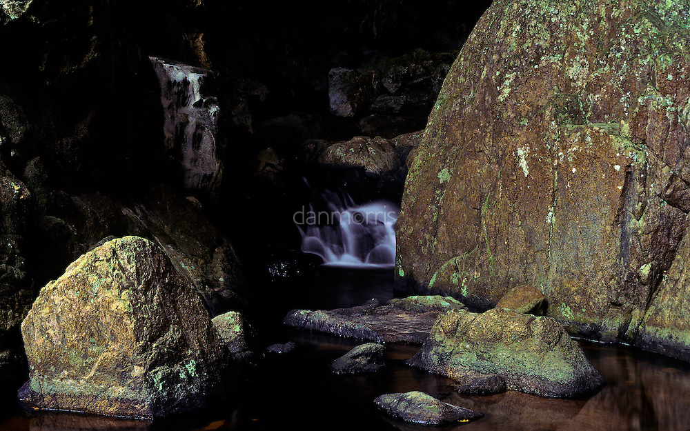 Waterfall and boulders at the entrace to Rio Om Cave, San Ignacio, Belize