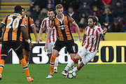 Stoke City midfielder Joe Allen (4) takes ball away from Hull City midfielder Sam Clucas (11) during the Premier League match between Hull City and Stoke City at the KCOM Stadium, Kingston upon Hull, England on 22 October 2016. Photo by Ian Lyall.