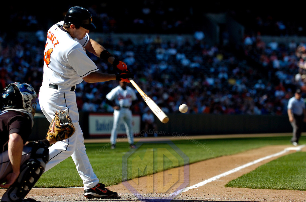 22 April 2007:  Baltimore Orioles second baseman Chris Gomez (14) flies our to center field in the 7th inning against the Toronto Blue Jays.  The Orioles defeated the Blue Jays 7-3 at Camden Yards in Baltimore, MD to complete a 3 game sweep.