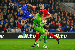 Watford Forward Matej Vydra (CZE) comes barelling in over Cardiff Goalkeeper David Marshall (SCO) during the first half of the match - Photo mandatory by-line: Rogan Thomson/JMP - Tel: Mobile: 07966 386802 23/10/2012 - SPORT - FOOTBALL - Cardiff City Stadium - Cardiff. Cardiff City v Watford - Football League Championship