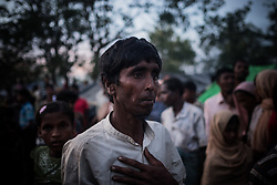 Refugee camp, Ukhia, Bangladesh. A desperate Rohingya refugee, waiting for food supply. He just arrived from Burma on foot.<br />