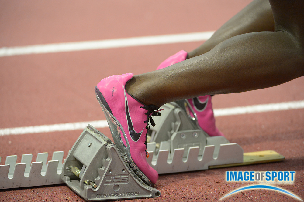 Mar 14, 2014; Albuquerque, NM, USA; General view of the pink Nike spikes of Destinee Gause of Florida in the starting blocks of a womens 200m heat in  the 2014 NCAA Indoor Championships at Albuquerque Convention Center.