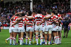The Japan team huddle together after the match - Mandatory byline: Patrick Khachfe/JMP - 07966 386802 - 23/09/2015 - RUGBY UNION - Kingsholm Stadium - Gloucester, England - Scotland v Japan - Rugby World Cup 2015 Pool B.