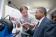 18208Student Reasearch & Creativity Activity Fair Spring 2007..President McDavis & Meng-Yun Chen demonstrates the Virtual Haptic Back
