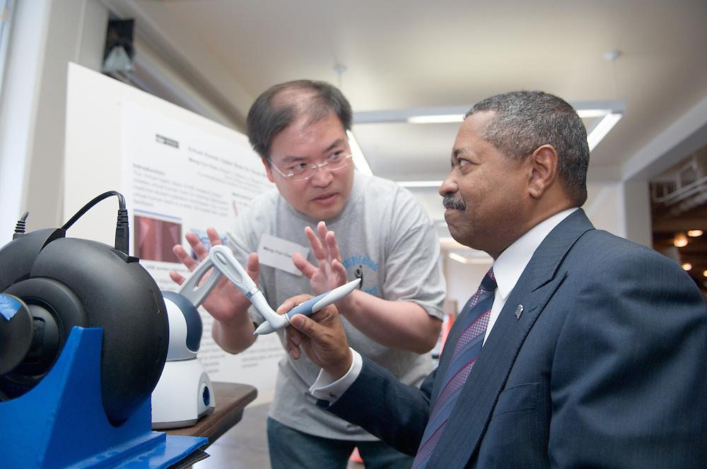 18208Student Reasearch & Creativity Activity Fair Spring 2007..President McDavis & Meng-Yun Chen demonstrates the Virtual Haptic Back