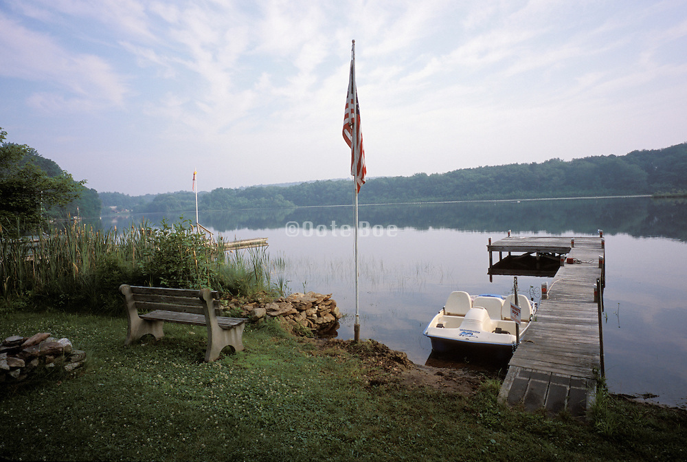 Scenic view with American flag boat and dock